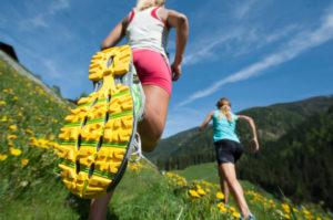 woman jogging in a green flower field